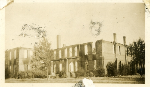 The building burned in the summer of 1934.  For the next two years classes were held downtown in the McDavid Hardware a